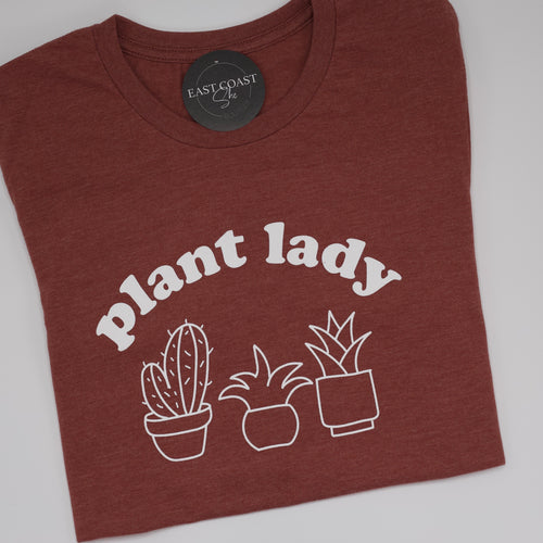 Plant Lady Tee-Find your perfect casual tops by searching our collection of women's tops online today! Shop trendy tanks, blouses, tees, t-shirts, bodysuits and more. New items added daily. Tops for women.-East Coast She, South Carolina