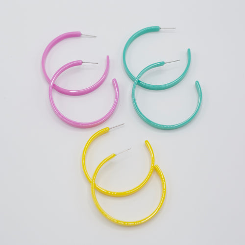 Kara Earrings-Simple acrylic hoops are the thing! These are so cute and lightweight and will go with most anything! The Kara Earrings feature soft pastels of acrylic in circular form with post backs! Soft pastels Acrylic Post backs Sizing - One size | 2