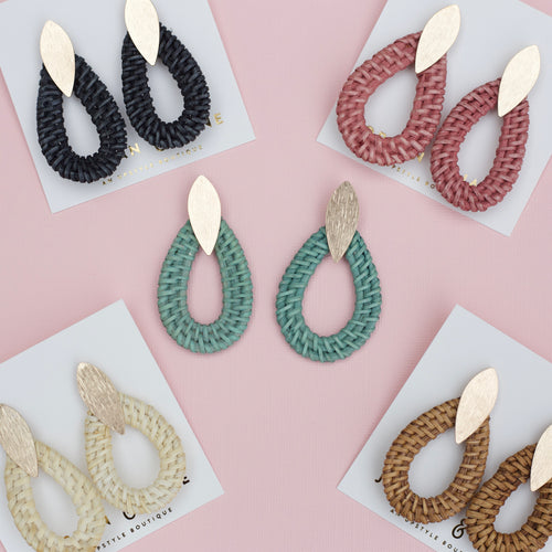 Assortment of colored rattan wicker teardrop jewelry earrings on teardrop gold