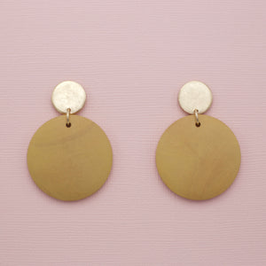 Tan colored round disk wood jewelry earrings on gold circle post