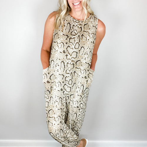 Greta Snakeskin Jumpsuit-Find your perfect casual jumpsuits by searching our collection of women's jumpsuits online today! Shop trendy dresses, jumpsuits, tops, leggings and more. New items added daily. Dresses, jumpsuits, tops, leggings and more for girls.-East Coast She, South Carolina