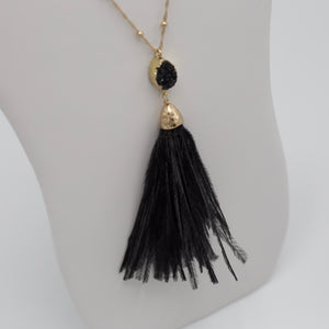 Black feather tassel jewelry necklace with black druzy stone pendant on thirty inch long gold chain
