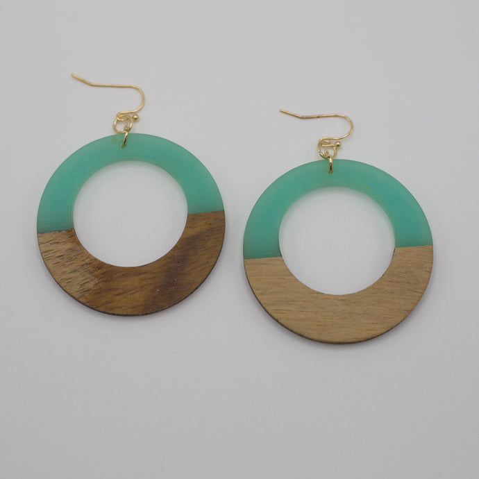 Half teal acrylic and half wood dangle hoop earrings on gold fish hooks.