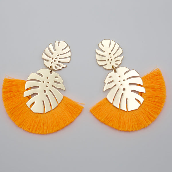 "Brendon Earrings-These earrings just scream white sands by the seashore! The Brendon Earrings have two attached gold palm leaves surrounded by either white or orange tassels. Gold palm leaves Tassels. Stud backs. Sizing - One size | 4"" Long New Arrivals!-East Coast She, South Carolina"