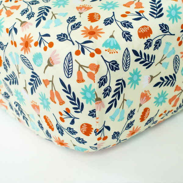 Cream Fitted Crib Sheet with Aqua, Navy, & Coral Florals