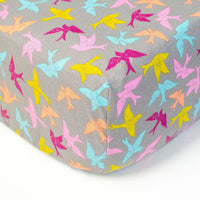 Grey Fitted Crib Sheet with Magenta, Aqua, & Yellow Birds