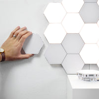 Modular Hexagonal touch sensitive wall lamp perfect for any decoration. Turn any wall in to a piece of art