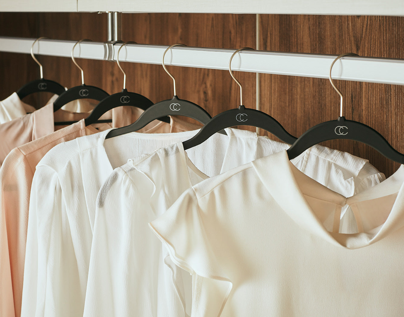 Black Hangers with White Blouses in Custom Closet