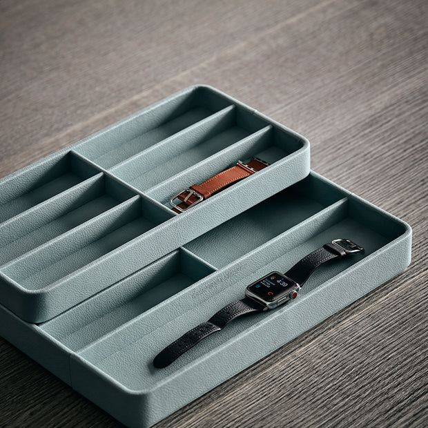 Presidio Smart Apple Watch Nesting Storage Trays in Ice Blue Finish on Table