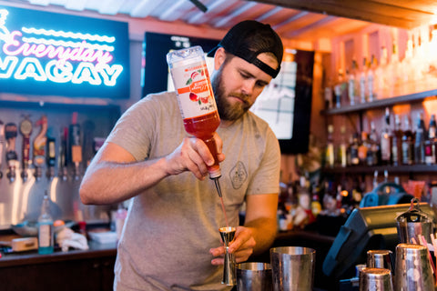 Bartender making a Blood Orange cocktail with sugar free blood orange syrup