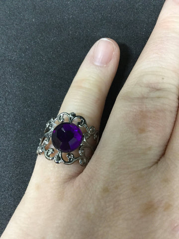 Purple stone on gunmetal adjustable filigree ring