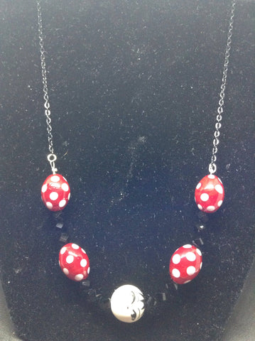 Smiling Face and Polka Dot Necklace
