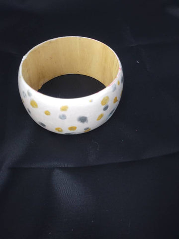 Pearly white wooden bangle with gold and silver polka dots