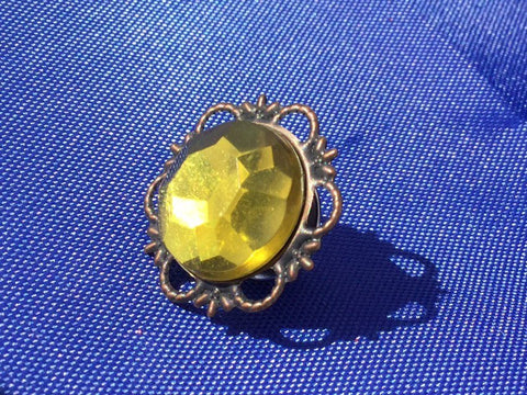 Yellow gem and antique brass vintage button brooch