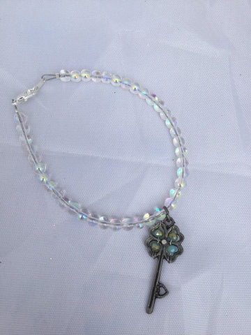 Clear Beaded Bracelet with Clover Key