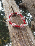 Red and white floral beaded bracelet