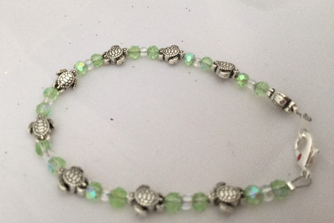 Silver turtle and clear & green glass beaded bracelet