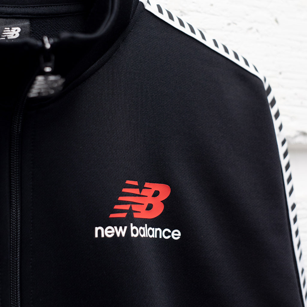 NEW BALANCE ESSENTIAL TRACK JACKET