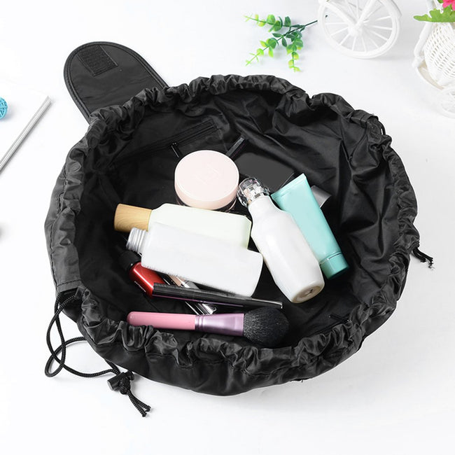 Carry all your make up around easily with our Quick Makeup Bag! Pull the drawstring cord and the bag cinches completely closed to stow or travel. You can now display all your makeup without taking it all out of the bag! Pack the bag in your suitcase and you're good to go! A smart and easy 4-in-1 solution: waterproof surface, quick cleanup, carryall,and storage.