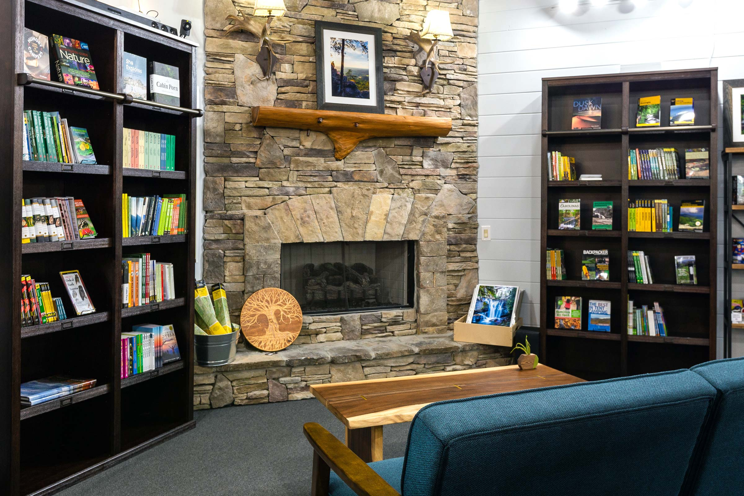Trailful Outdoor Co - fireplace lounge and outdoor books in the mountains of Hiawassee, Georgia