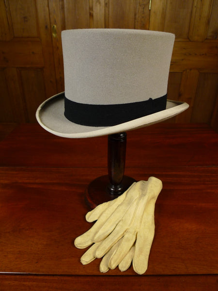 20/1081 grey felt top hat with ivory kid leather gloves 57 cms