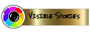 rainbow colours with camera lens for Visible Stories logo
