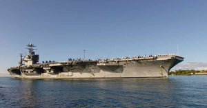 Military aircraft carrier in the ocean