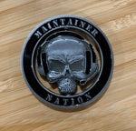 MX Spinner Coin with die-cut center skull and headset logo on wooden surface, from Challenge Coin Nation