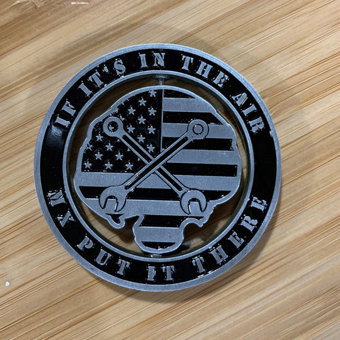 Back of MX Spinner Coin with die-cut center American flag and crossed wrenches on wooden surface, from Challenge Coin Nation