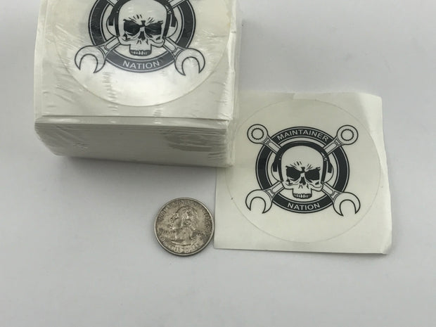 "Tall stack of MX Nation Logo Stickers with ""Maintainer Nation"" and skull and ""cross wrenches"" design from Challenge Coin Nation, with one sticker removed for display and a quarter for scale"