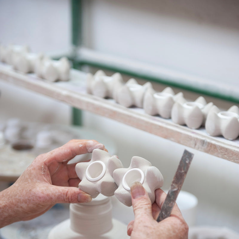 Handmade candle holders. Julia is checking every single item. Before glaze. Buy the beautiful candle holders online at JAHOKO.COM