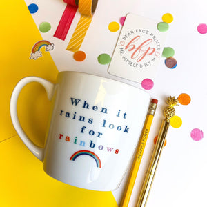 White and bright coloured rainbow ceramic positivity mug