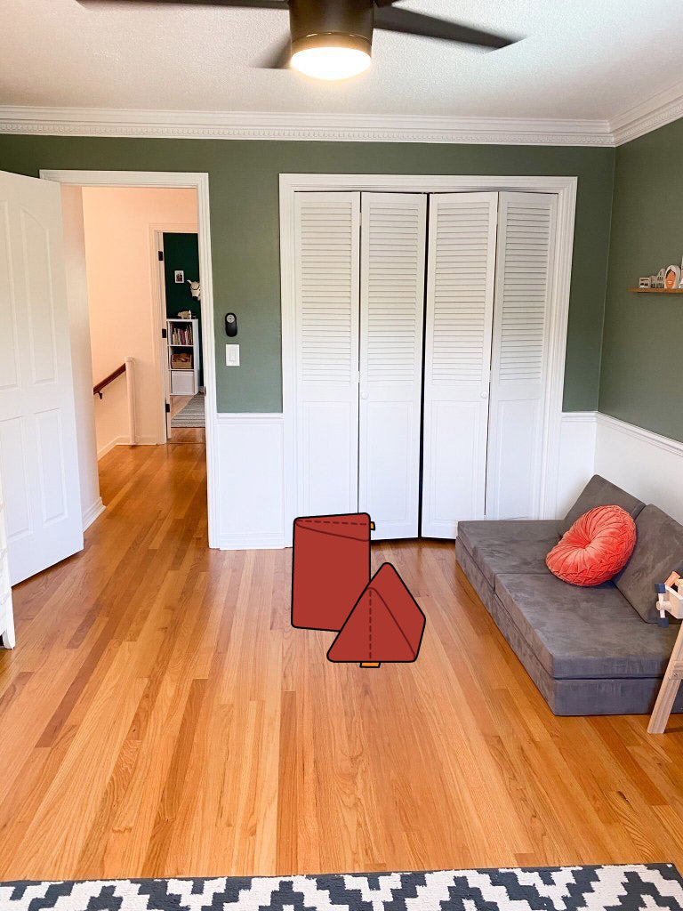 Room with light hardwood floors, green walls, white closet doors, Harbor Nugget couch, and added Redwood pillows illustration