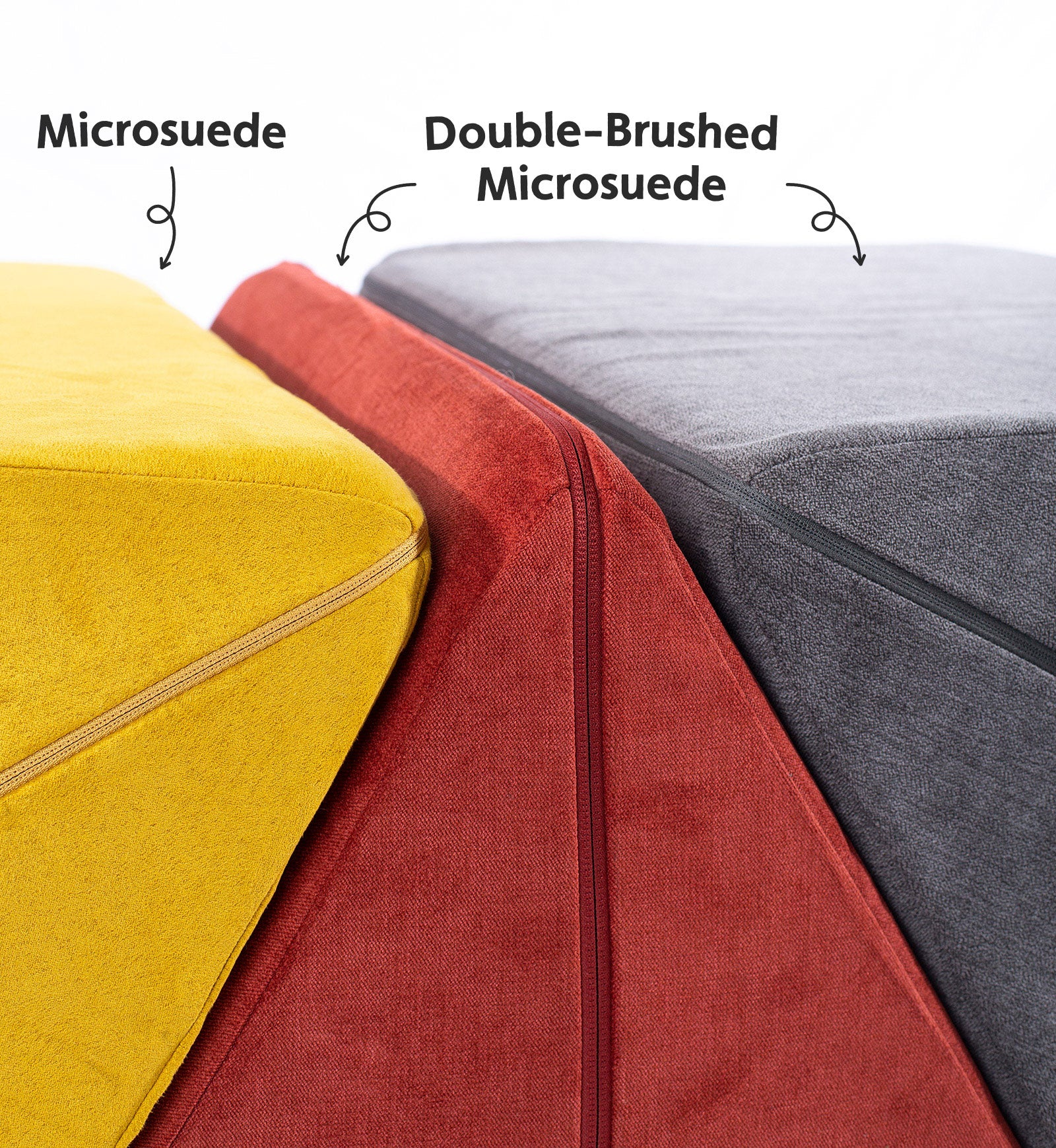 Three Nugget pillows with different color covers stacked side by side, one microsuede in Saturn, and two in double-brushed microsuede in Redwood and Harbor