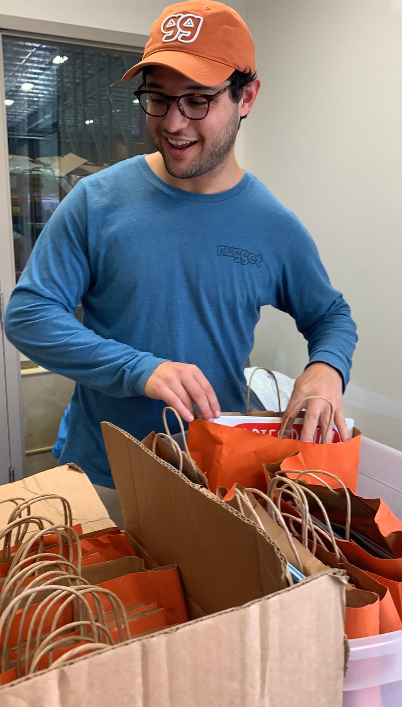 David, CEO, looking delighted as he peers into the book bags
