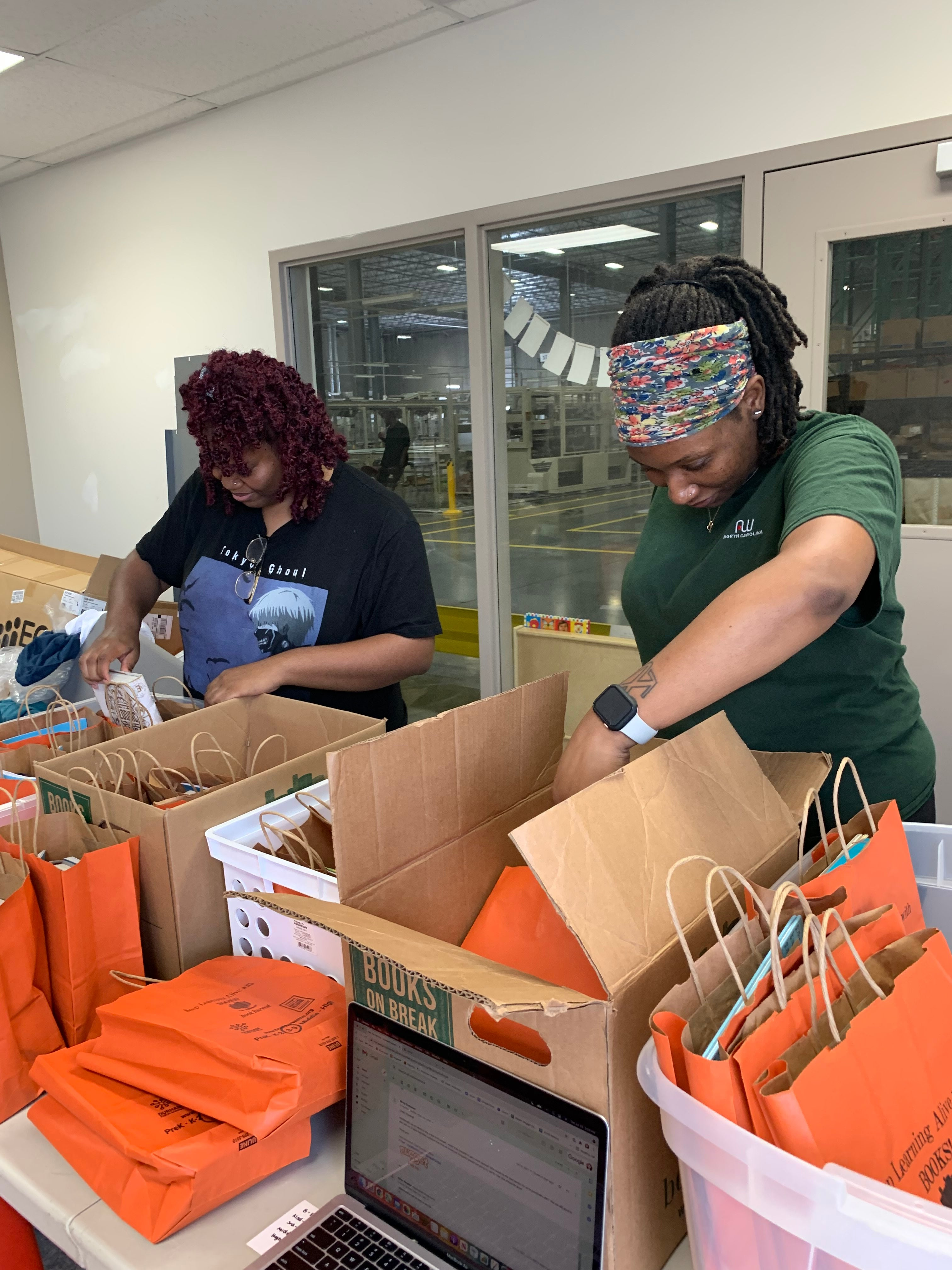 Two Nugget team members sorting through donated books from Book Harvest