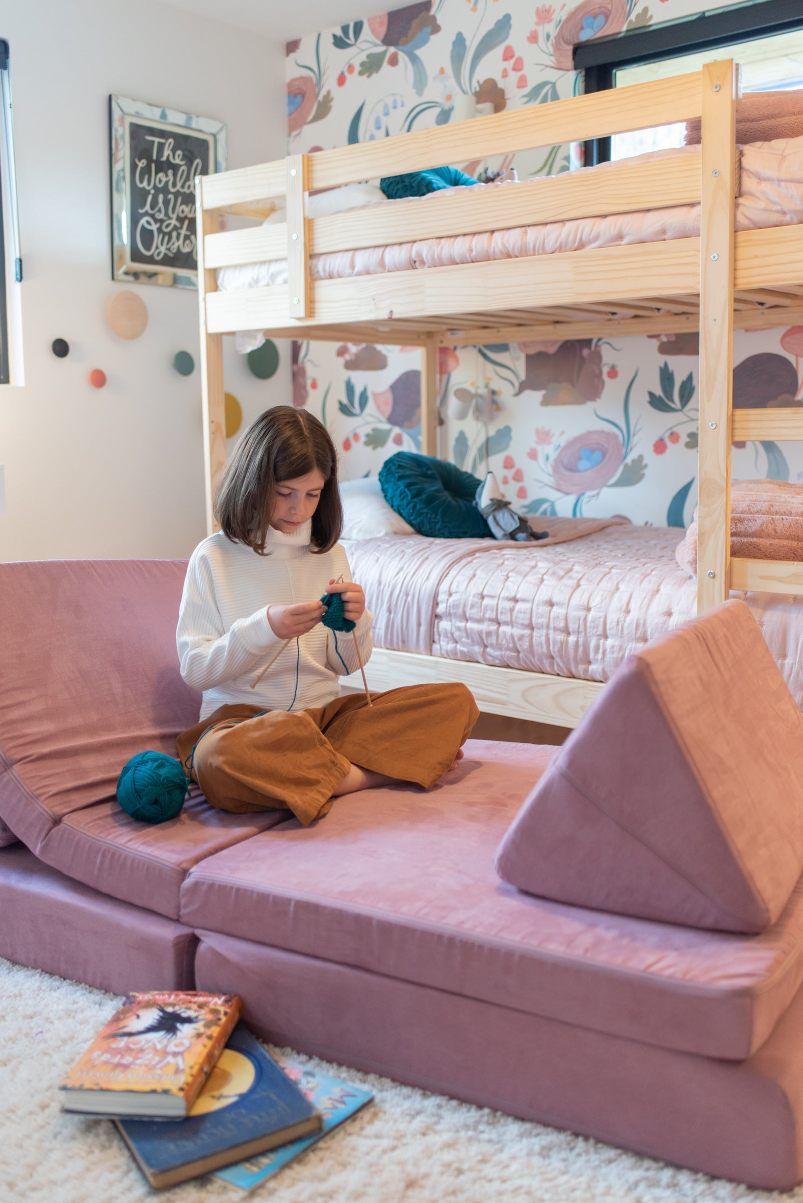 Child sitting on a Mayberry Nugget knitting, Anewall wallpaper on background wall