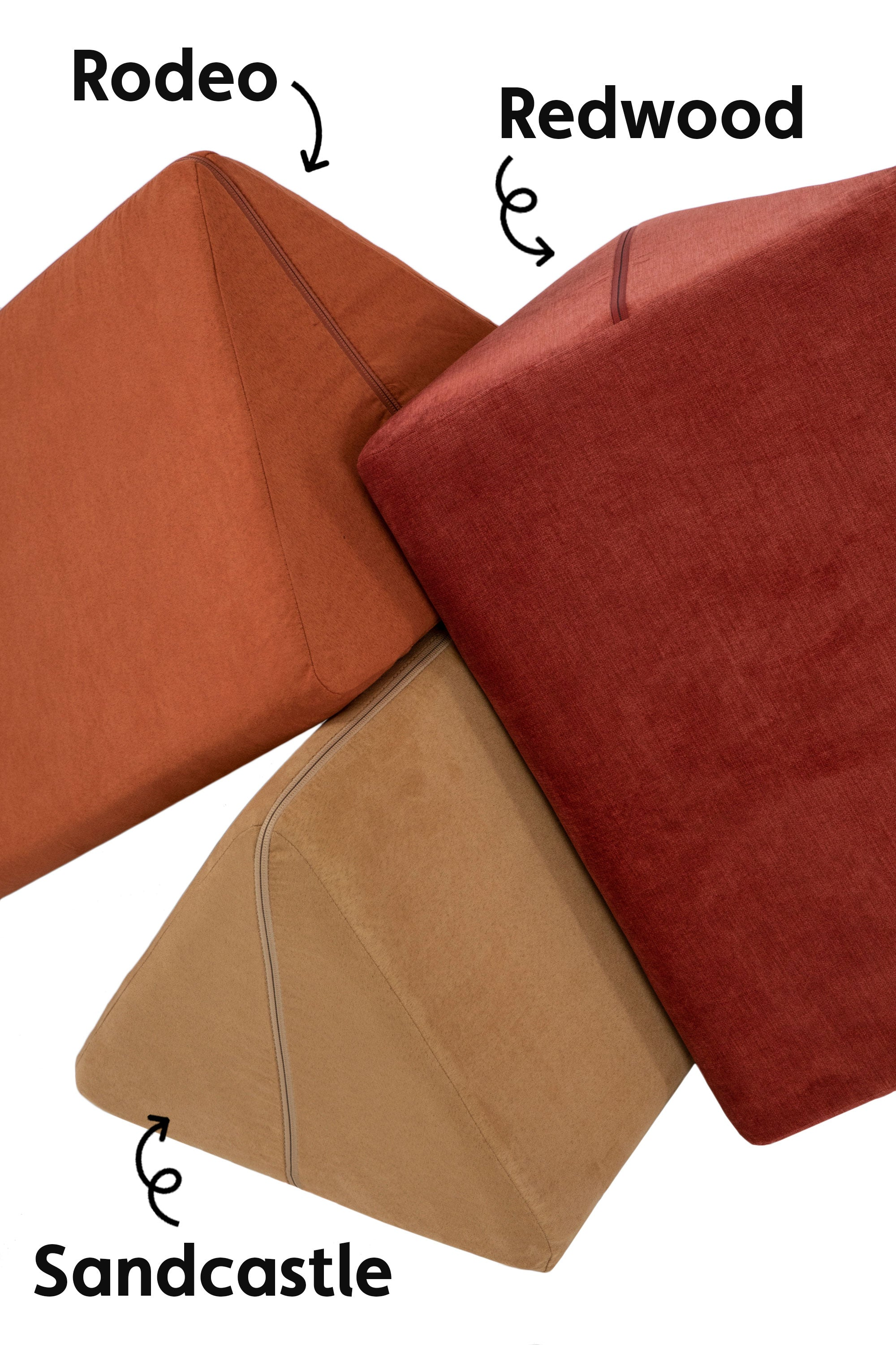 Three Nugget pillows stacked up to show a color comparison: Rodeo, Sandcastle, and Redwood, from left to right.