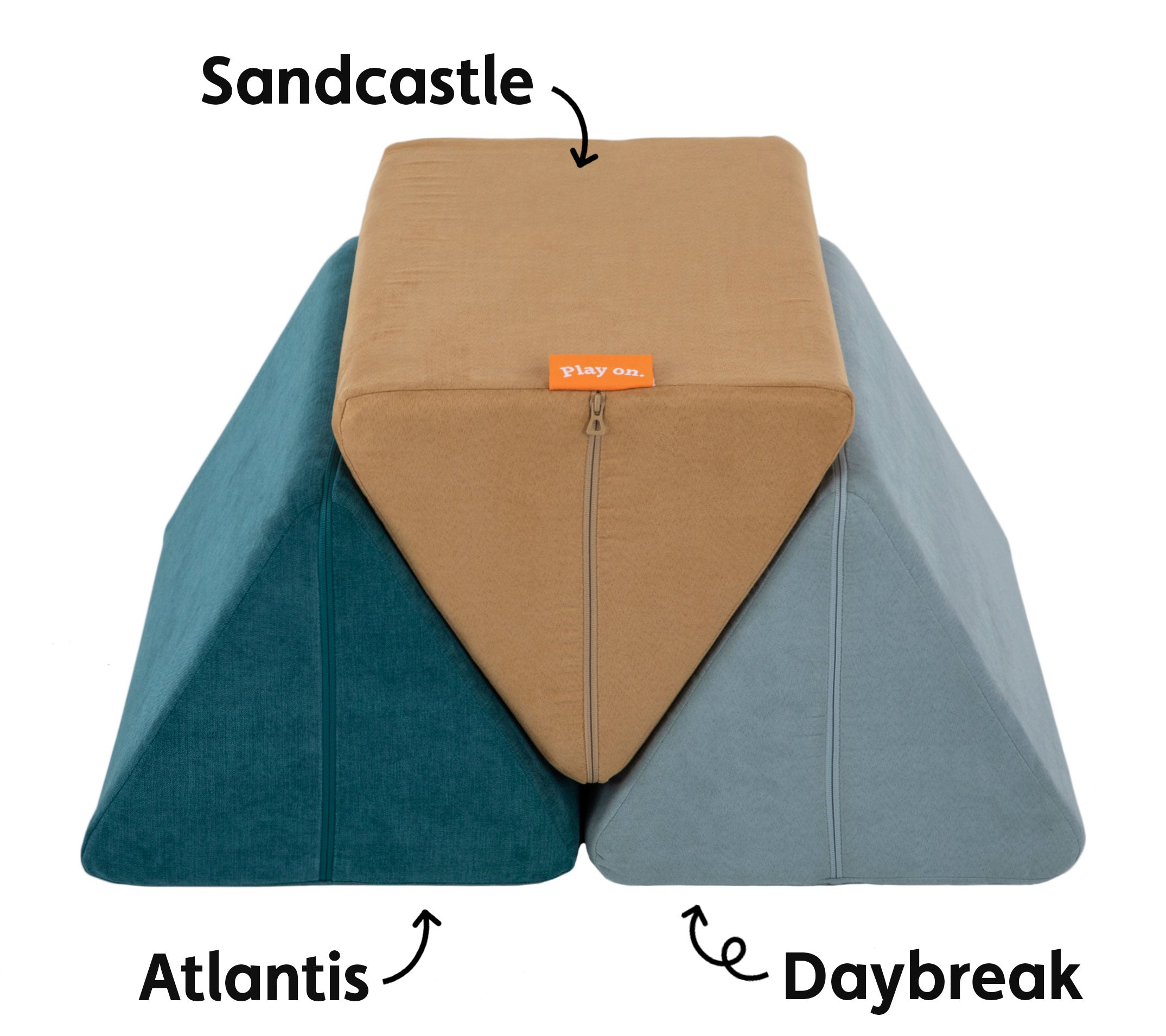Atlantis, Sandcastle, and Daybreak Nugget pillows stacked side by side