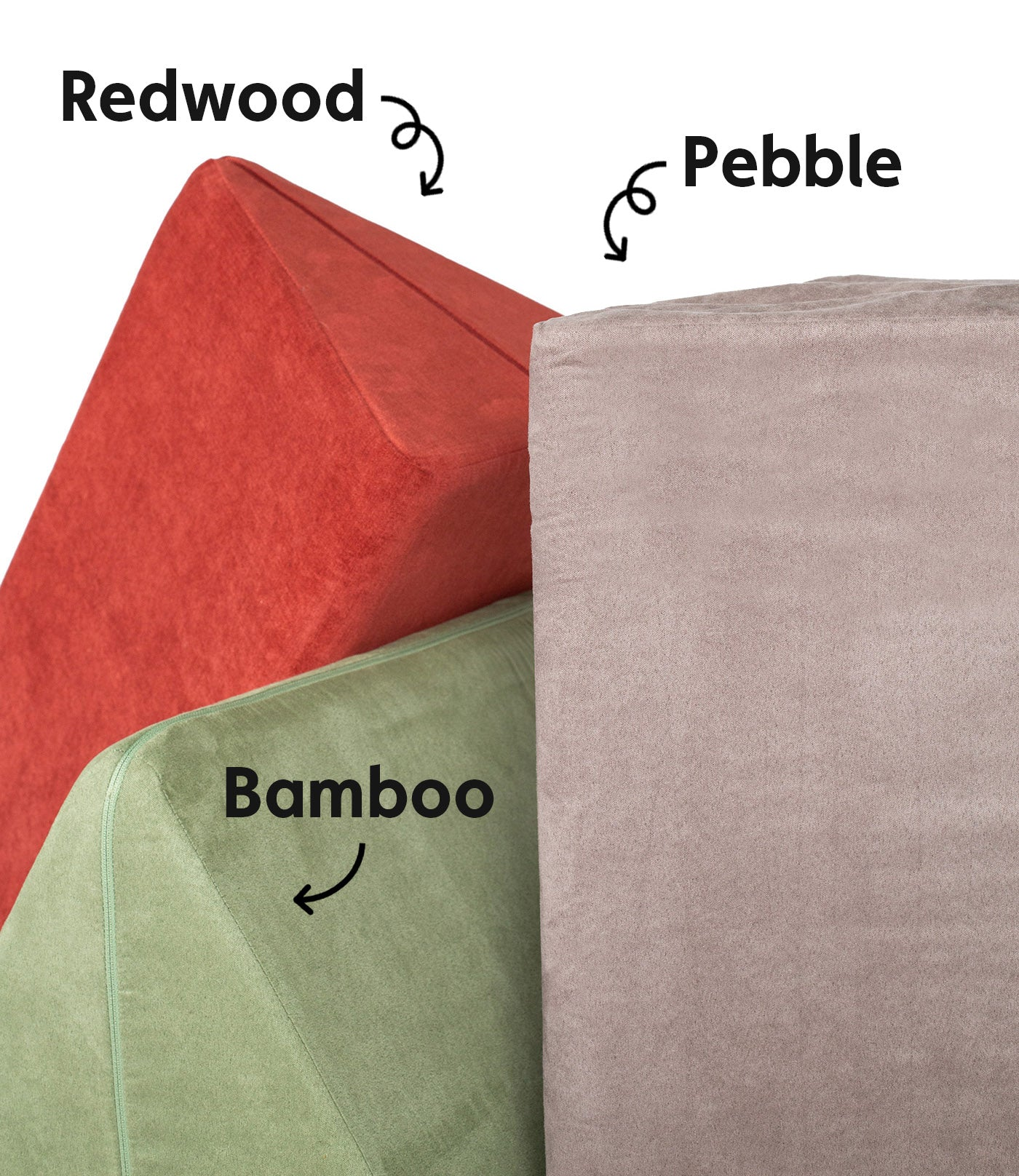 Redwood, Bamboo, and Pebble pillows artfully arranged, labeled with names and arrows
