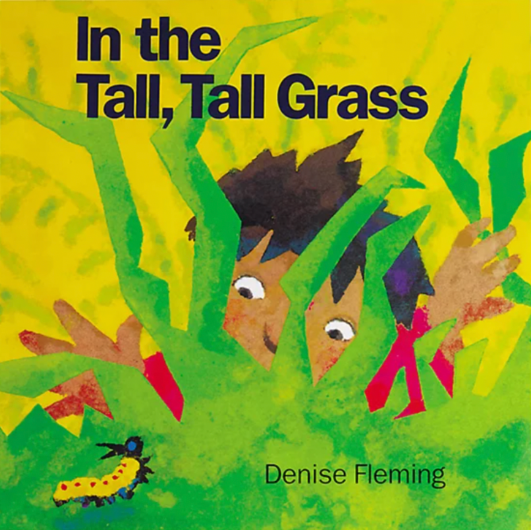 """Cover of """"In the Tall, Tall Grass,"""" a young child peeking through grass at a caterpillar"""