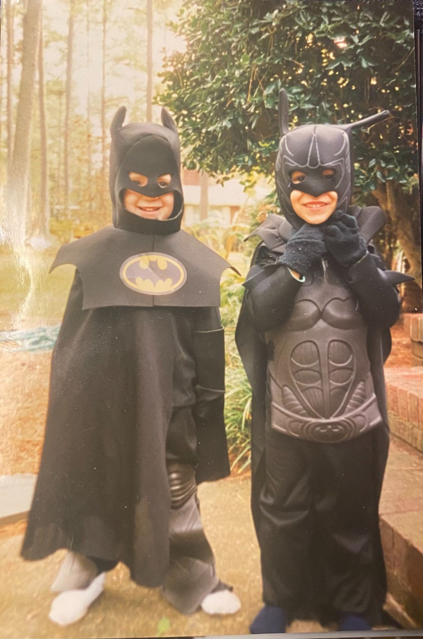 Two kids dressed up as Batman, with masks and capes