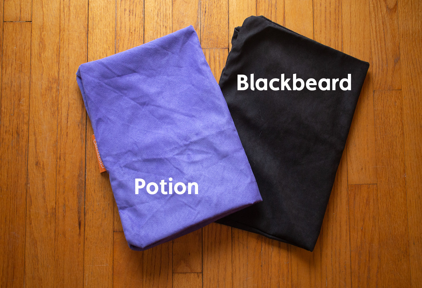 Color comparison of Nugget cover sets in Potion, an enchanting ultraviolet, and Blackbeard, a true onyx black