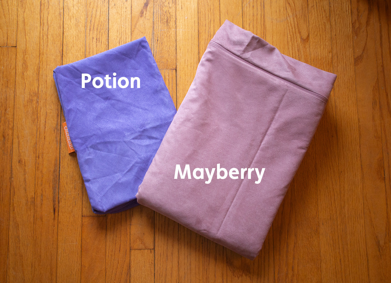 Color comparison of two Nugget cover sets: Potion, an enchanting ultraviolet, and Mayberry, a modern mauve.