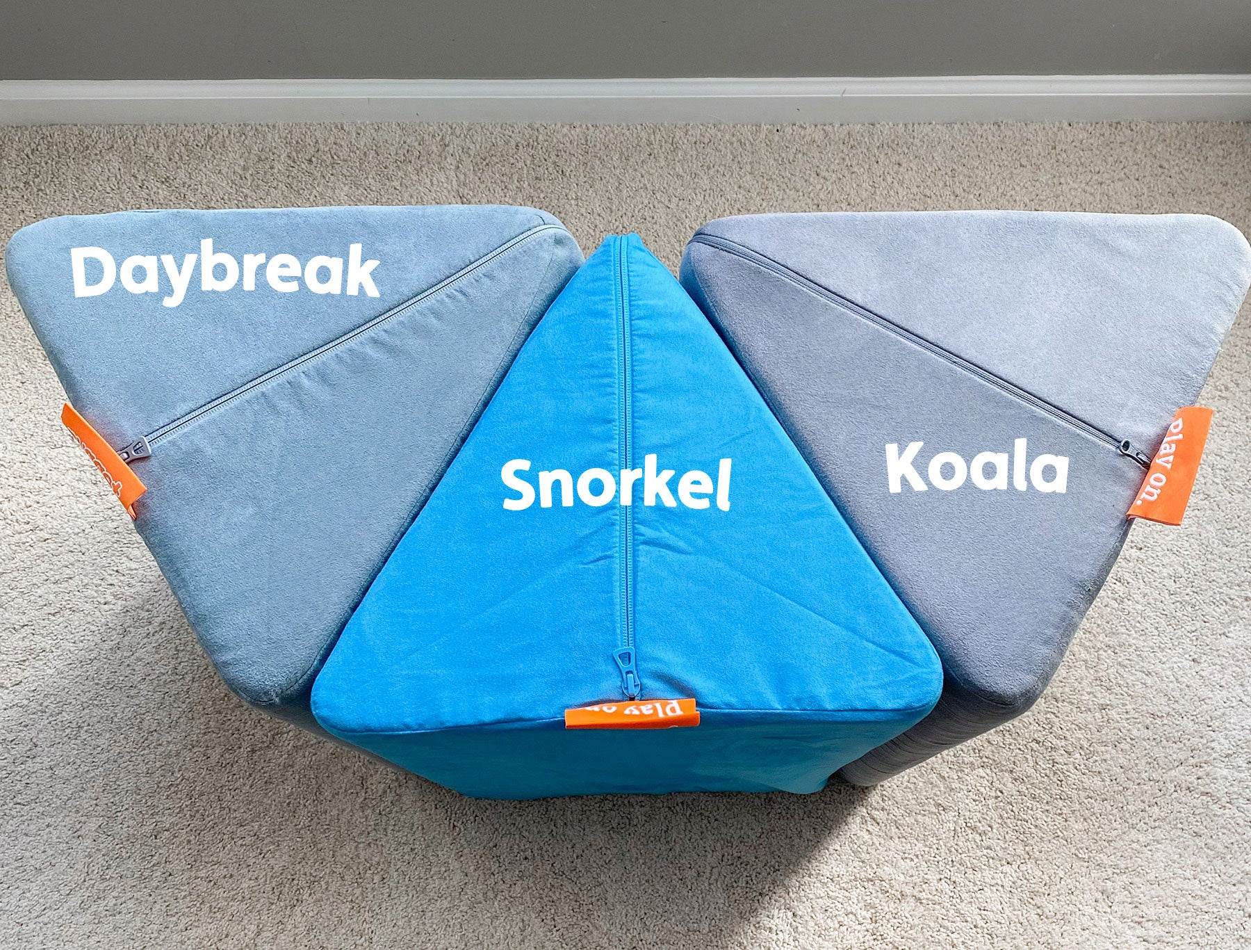 Photo comparing pillows in different Nugget colors: Daybreak —a warm, pale blue; Snorkel — a bright, popping aquamarine; Koala — a cool, light gray