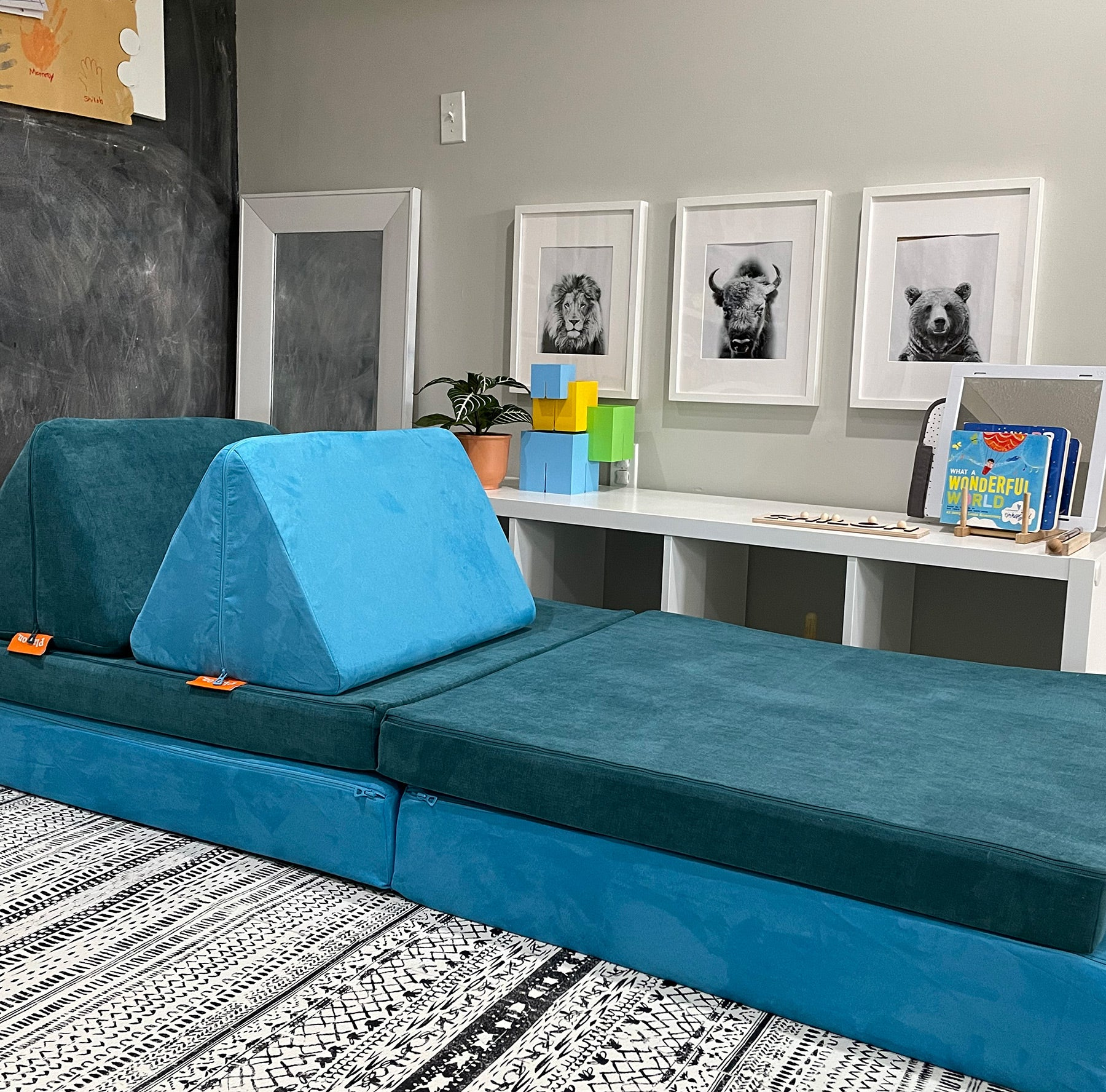 Nugget in a playroom made from two different colors: Snorkel, a popping, bright aquamarine, and Atlantis, a textured teal blue