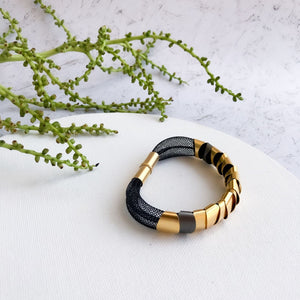 Modern black and gold bracelet
