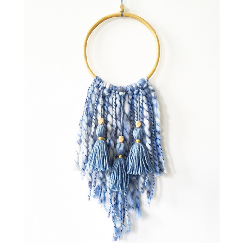 blue chunky yarn tassel wall hanging