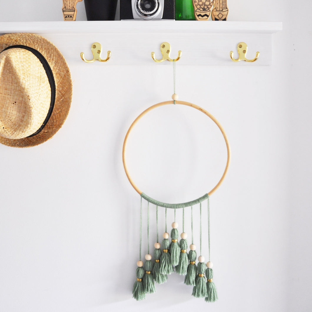 large sage green tassel wall hanging