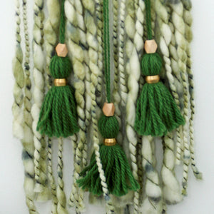 green chunky yarn tassel wall hanging